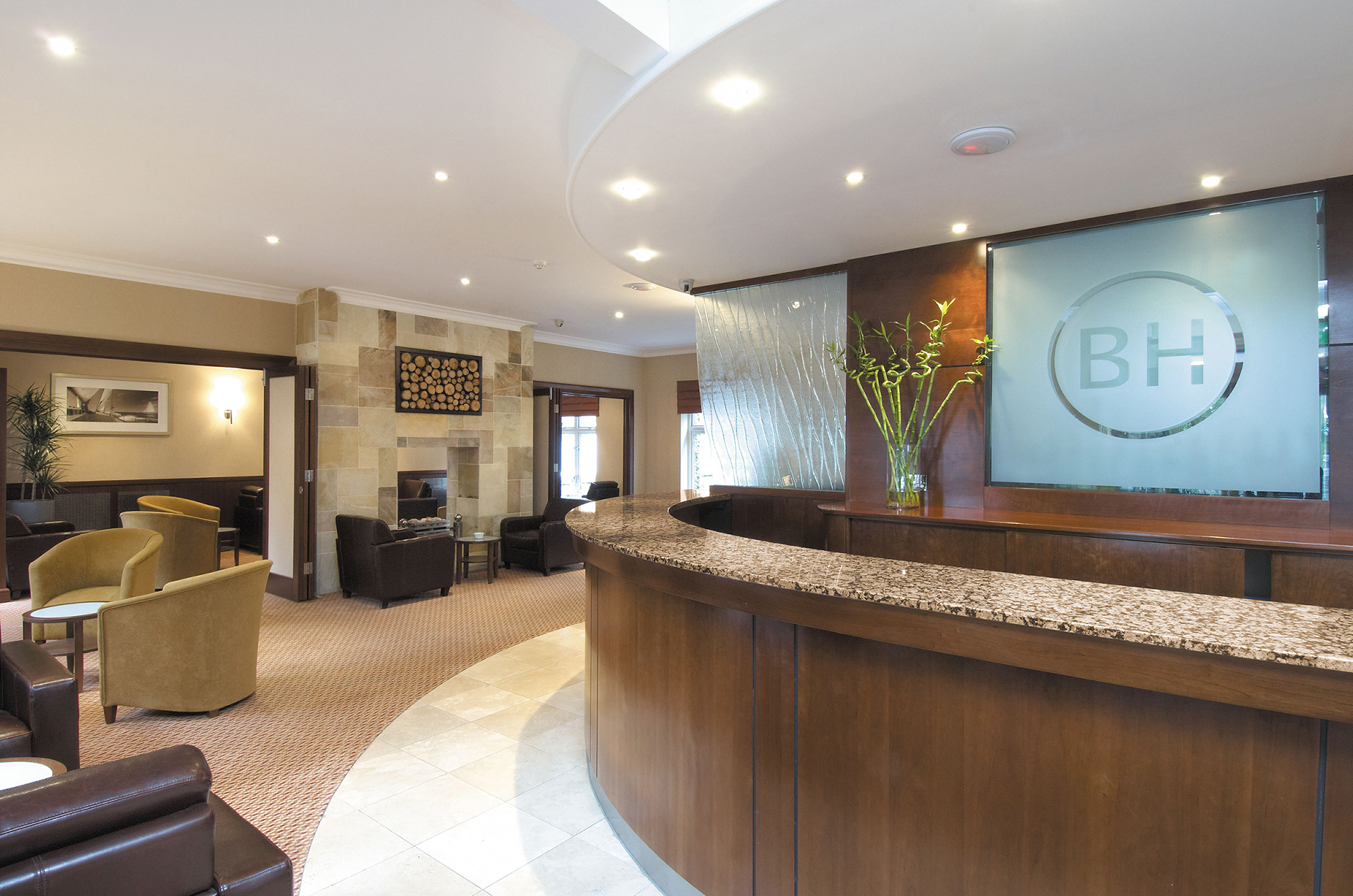 walls were removed to open up the space which features an art deco inspired reception bar unit specially designed carpet travertine flooring and an open - Travertine Hotel 2015